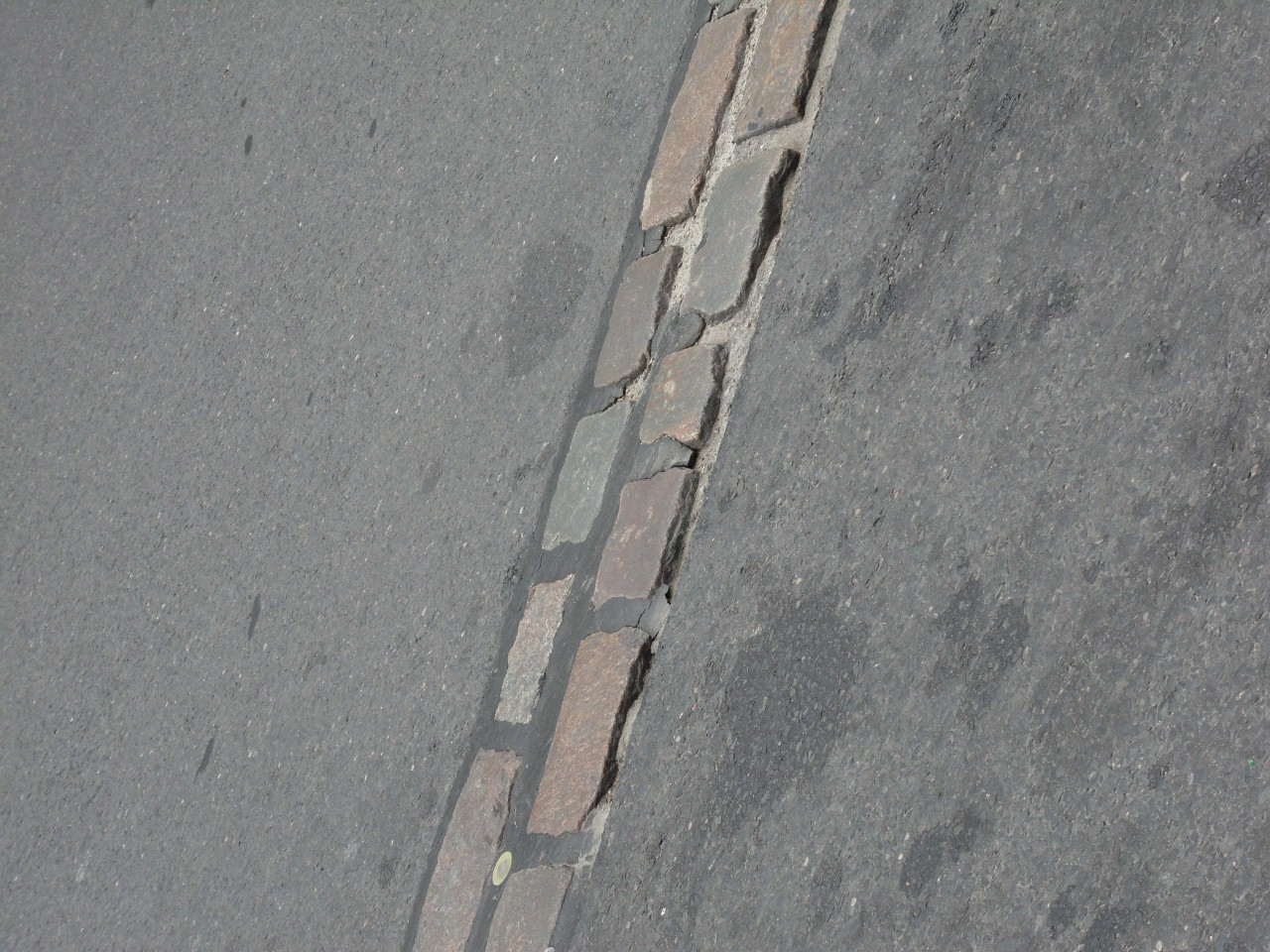 The Berlin wall is marked by these two bricks anywhere it has been removed